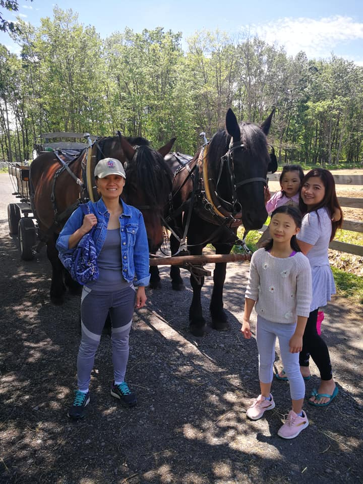 Family in Front of Wagon Horses